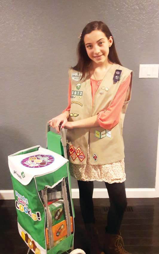 Westminster Girl Scout Rhianna Dains, 14, gets ready for Girl Scout Cookie sales. She and her troop of eight girls are using their cookie money to save for a scuba diving trip in the Bahamas in 2020. This year, cookie sales began on Feb. 3 and will continue through March 10.