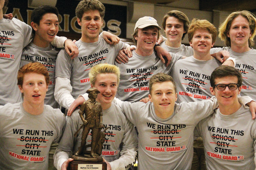 The Arapahoe High School boys varsity soccer team poses for photos Jan. 30 at a ceremony to honor them as part of the MaxPreps Tour of Champions. The team received the national accolade during halftime at an Arapahoe basketball game at the school.