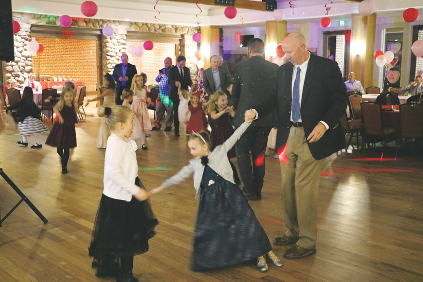 Dads and daughters take over the Highlands Ranch Mansion on Feb. 1 for HRCA's Father and Daughter Sweetheart Ball. The event's three sessions over the weekend sell out every year.