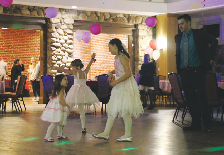 Dads and daughters show off their dance moves at HRCA's Father and Daughter Sweetheart Ball at the Highlands Ranch Mansion. The Feb. 1 event drew more than 200 guests.