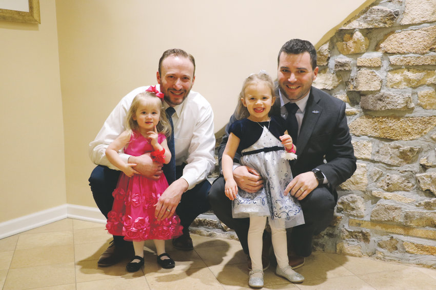 Chris Kelly, left, and his 2-year-old daughter Kenley stand beside Jeff McKnight and his 3-year-old daughter Avery at HRCA's Father and Daughter Sweetheart Ball on Feb. 1. Held at the Highlands Ranch Mansion, the event has three sessions over the weekend that sell out every year.