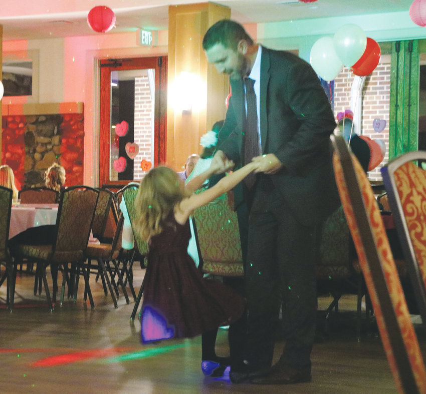 Eric Lance and his daughter Brynley share a dance at HRCA's Father and Daughter Sweetheart Ball on Feb.1 at the Highlands Ranch Mansion. The special evening featured photo ops, treats and sleigh rides.