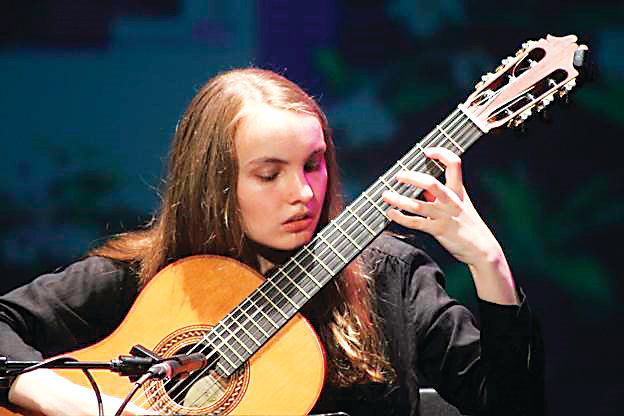 Young guitarist Gwenyth Aggeler and her instructor, Master Guitarist Alex Komodore will perform in a free concert at 7:30 p.m. Feb. 8 at Littleton United Methodist Church.