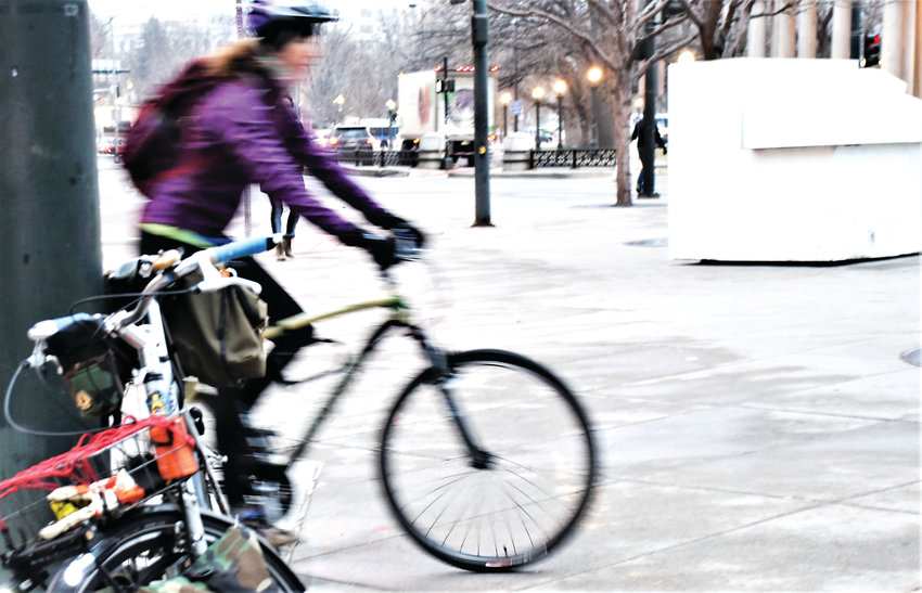 A rider rolls into downtown Denver last year as a part of the 2018 Winter Bike to Work Day. So far, Denver and Boulder have the most riders committed for the Feb. 8 event.
