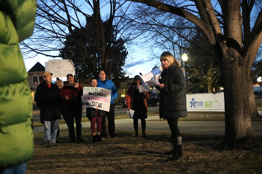 About two dozen protestors stand outside of Douglas County School District's administrative building in Castle Rock prior to a Feb. 5 school board meeting. The group voiced concerns over the school board's handling of a teacher at the center of controversy and district policy on public comment.