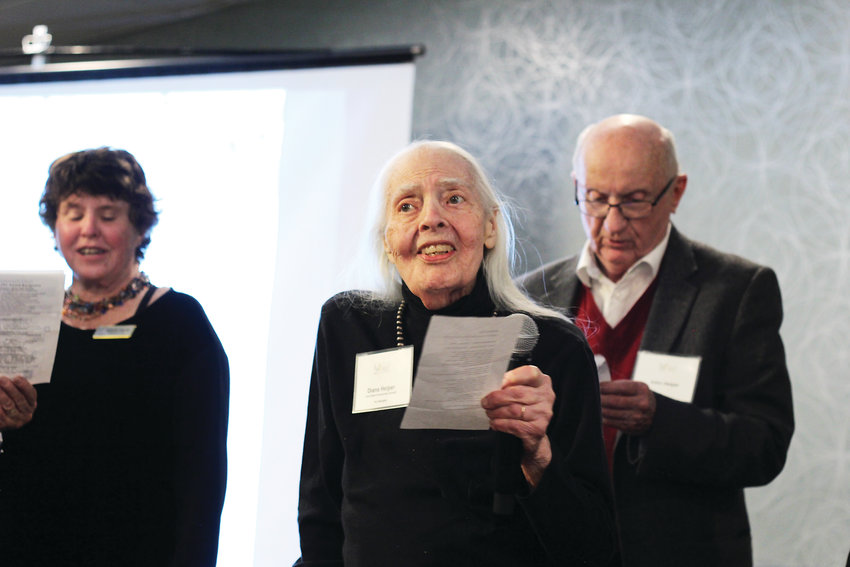 "Diana Helper, center, sings a song she wrote to the tune of ""Oh Susanna"" at the 33rd annual Denver INC Awards. The song wrapped up the award ceremony on Jan. 23."