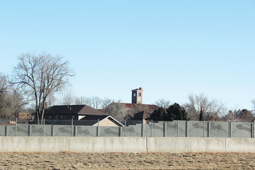 Residents on the south side of the interstate did not want to build a sound wall because they feared it would block their view of South High School. The tower of the school can be seen just north of the residential area.