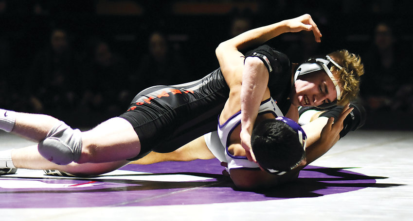 Arvada West junior Dylan Kruse, left, works on Pomona's Jacob Judd during the conference dual Jan. 31 at Arvada West High School. Kruse is a returning state placer for the Wildcats. He took sixth at 113 pounds last season