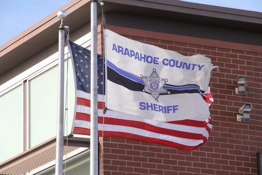 Flags fly at the Arapahoe County Sheriff's Office in the Centennial area.