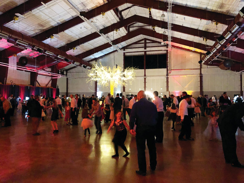 Fathers and daughters packed the event center at the Douglas County fairgrounds for the 2019 Daddy Daughter Ball in Castle Rock.