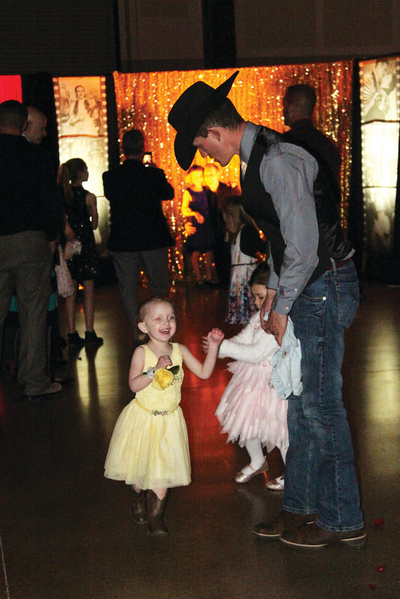Aaron Shue dances with daughter Evelynn, 2, at the Daddy Daughter Ball in Castle Rock on Feb. 9.