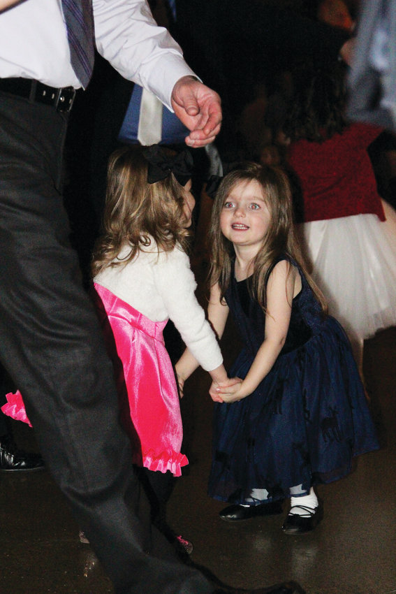 Natalie Camfferman, 3, dances with Parker Arbaiza, 3, at the Daddy Daughter Ball on Feb. 9.