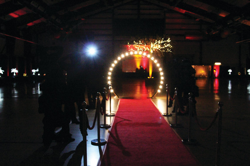 "This year's theme of the Daddy Daughter Ball in Castle Rock was ""Vintage Hollywood."" Greeting people as they came in was a red carpet and cardboard cutout ""paparazzi."""