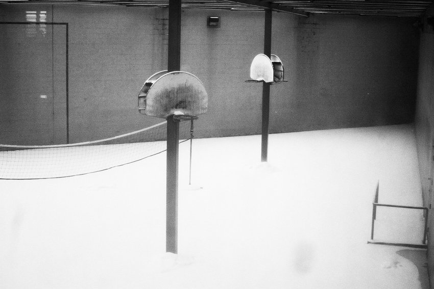 Snow blankets the jail's recreation yard, which was designed for a fraction of the current inmate population.