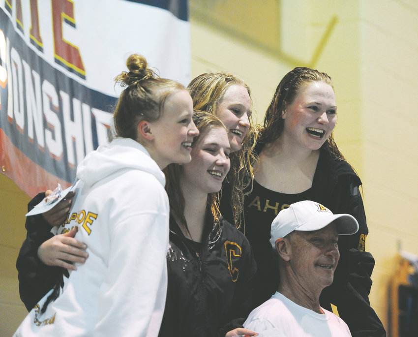 Diving coach Jeff Smith is surrounded by Arapahoe divers who qualified for the CHSAA Girls State Swimming and Diving championships. From left to right are Kyndall Tatum, Kirsten Belitz, who finished second in the finals, Morgan Hampton, who was seventh, and state champion Franny Cable.