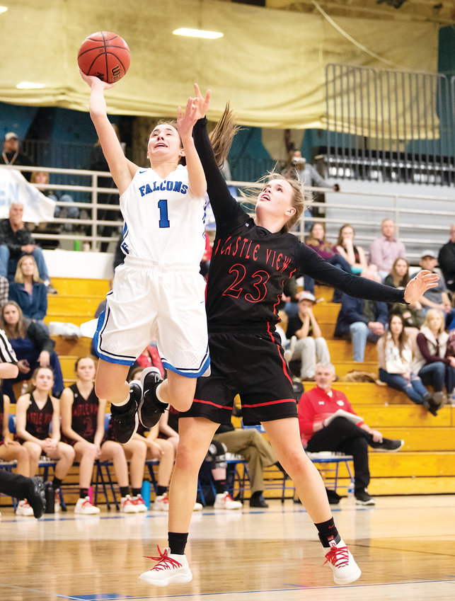 Highlands Ranch's Payton Muma goes in for a layup as Castle View's Alexis Smith tries to get a hand in her way. Muma led all scorers with 17 points as Highlands Ranch ended up on top 75-27 on Feb. 8.