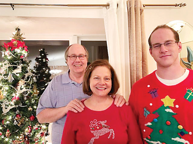 Ryan Carter, right, with his mom and dad Tracy and Rod Carter, in a recent Christmas photo. Carter, 27, was killed in a car wreck by a woman fleeing police on Feb. 6. Rod and Tracy said their son was quiet and loving.