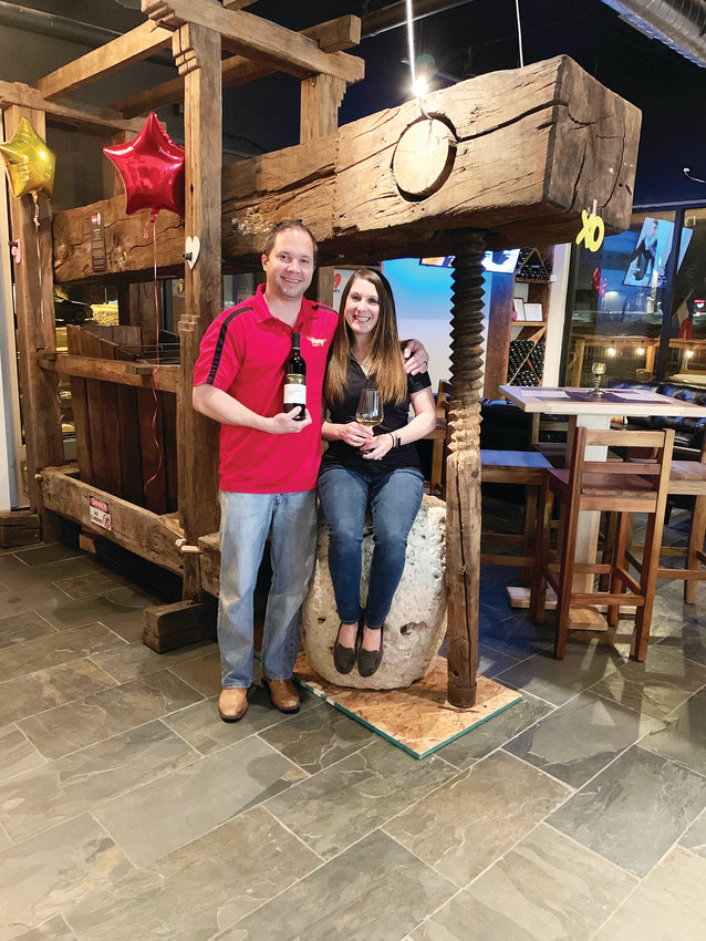 Ashlee and James Brejcha, a couple from Parker, stand in their newly opened business, Purgatory Cellars Winery, 30 Springer Dr., in Highlands Ranch. The couple opened their doors in late January.