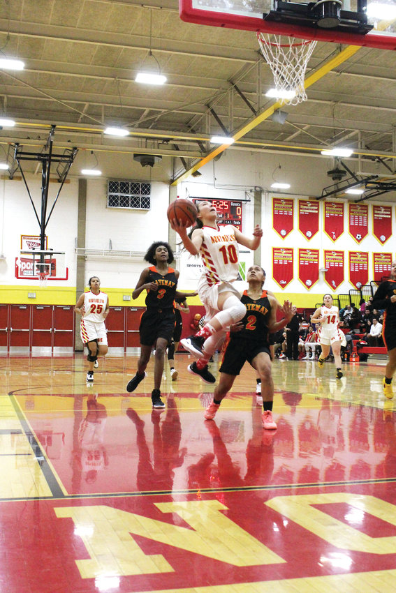 Lady Norse senior Ryan Paswaters goes up for the layup Feb. 11 against Gateway on Senior Night.