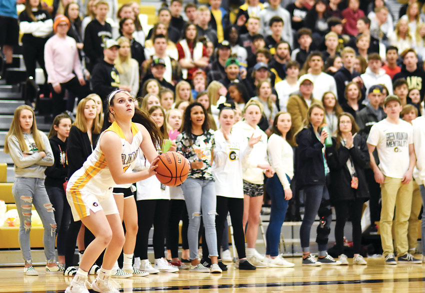 Green Mountain junior Riley Shoemaker squares up for a 3-pointer in front of the Rams' student section Feb. 22 at Green Mountain High School. The Rams defeated Pueblo County 48-46 to earn a trip to the Sweet 16 against Greeley Central.