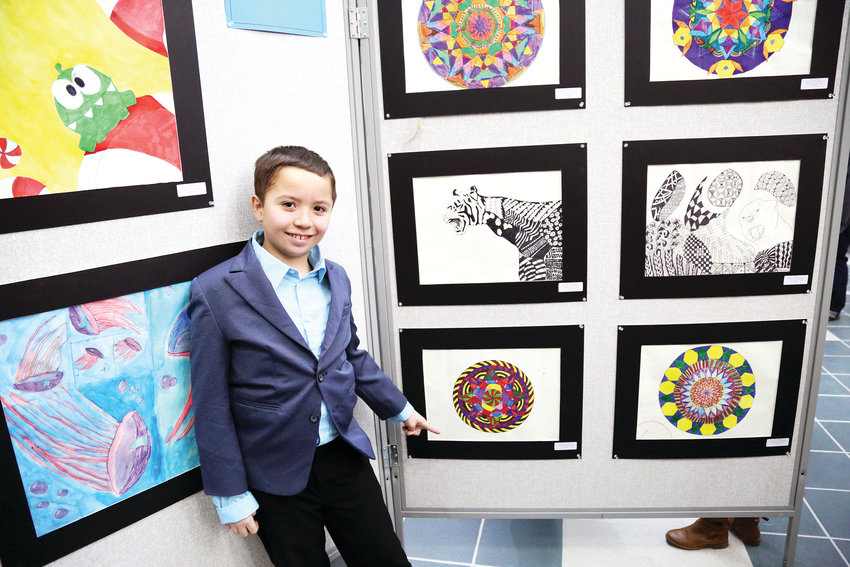 Weber Elementary student Marcus Mercado shows off his drawing at the opening reception of the 2019 Elementary Jeffco Schools Foundation Art Exhibit held Feb. 22.
