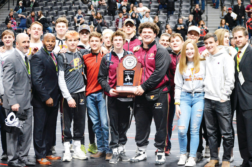 Senior state champions Mosha Schwartz (left) and Cohlton Schultz hold the runner-up trophy as Ponderosa finished second at the CHSAA State Wrestling Championships Feb. 23 at the Pepsi Center.