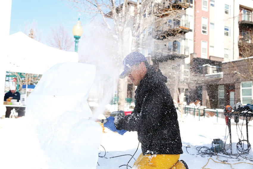 Ice sculptor Ian Kunter created two live ice sculptures during WinterFest in Olde Town Arvada Feb. 23.