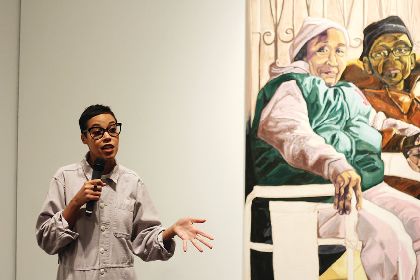 "Jordan Casteel stands in front of her painting ""Yvonne and James"" at the Denver Art Museum. Casteel was born and raised in Denver, and her new exhibition ""Returning the Gaze"" is showing until Aug. 18."