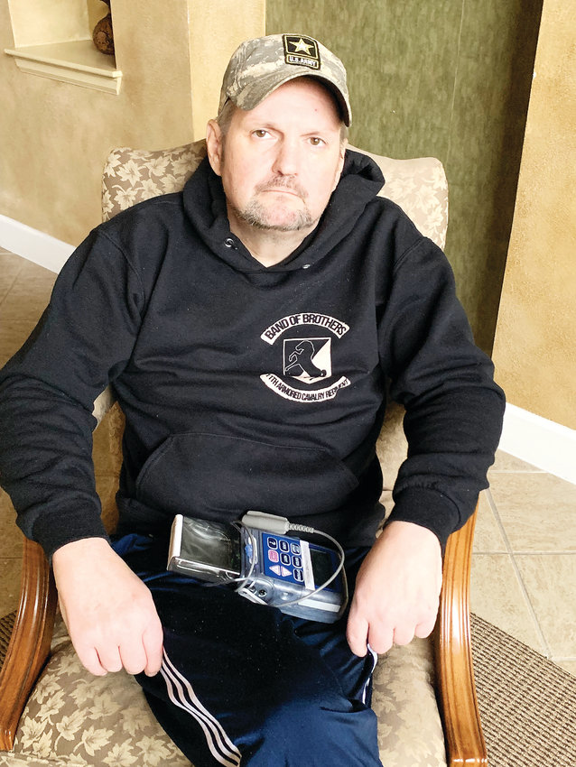 Christian Redman sits in the clubhouse of his Parker condominium complex, wearing the sweatshirt of his beloved Blackhorse regiment. Blackhorse veterans are planning a last ride for Redman, who is dying of cancer.