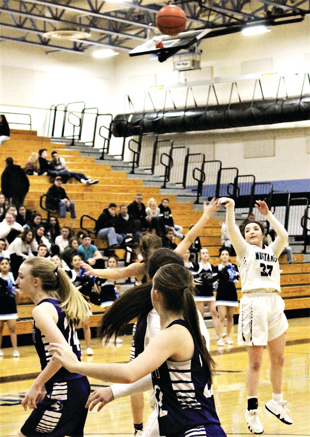 Lady Mustangs' senior Anna Giampietro launches the three-pointer against Douglas County Feb. 19 in the first round of the state tournament.