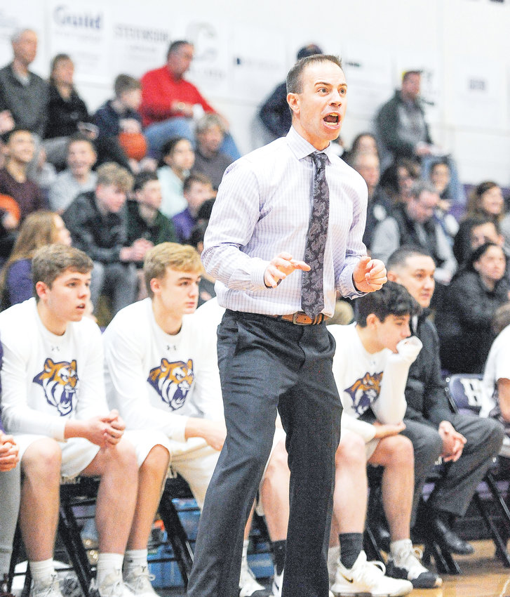 Holy Family Head Coach Peter Villecco yells instructions to his team, during the Feb. 23 CHSAA Boys 4A playoff game vs. Northfield. The Tigers turned back the visiting Nighthawks, 57-39, to advance into the Sweet 16.