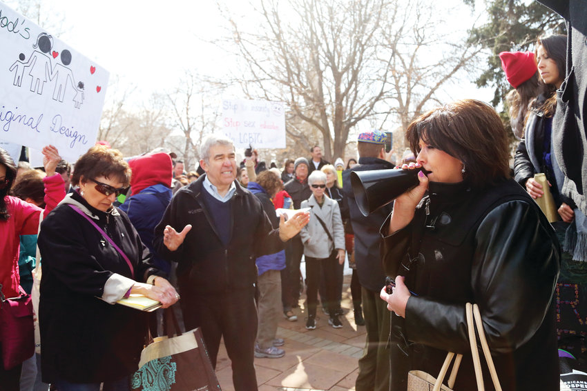 Debbie Chaves, of Colorado Family Action, leads the crowd in prayer Feb. 27 at a gathering in opposition to the proposed sex education bill.