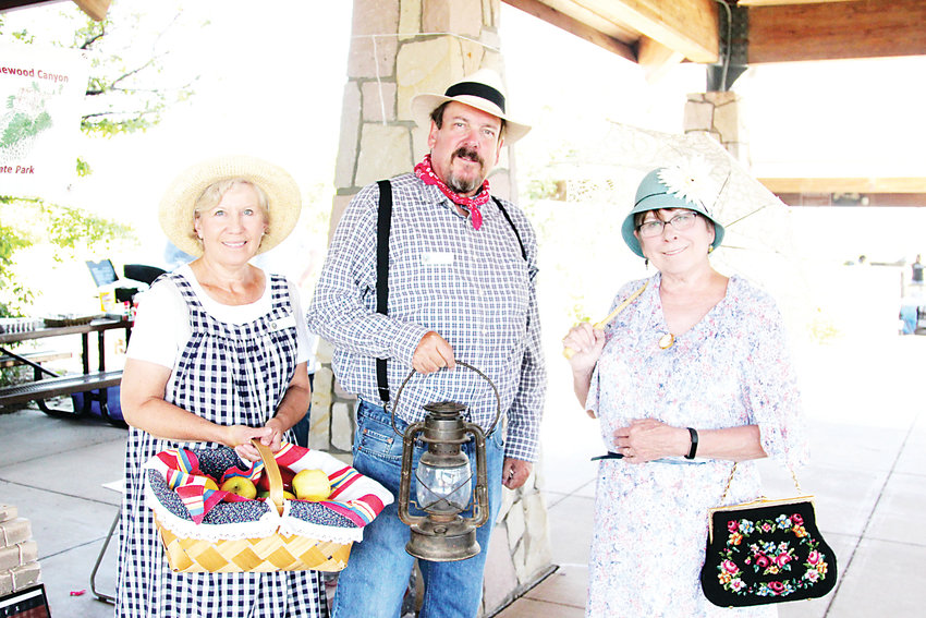 Pat Feldmeier, far right, portrays a resident who lived near the historic dam when it broke in 1933 at Castlewood Canyon State Park.