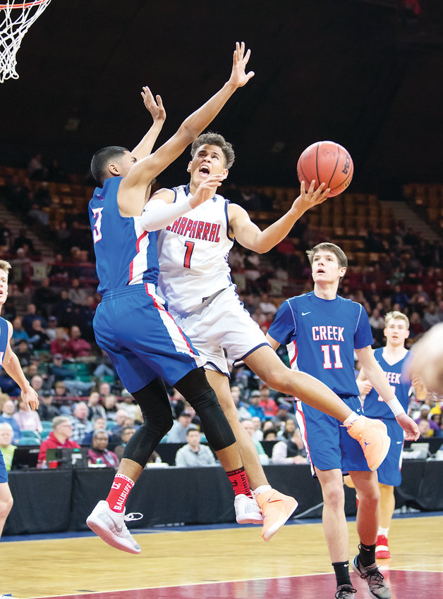 Chaparral's Kobe Sanders (1) drives the lane as Cherry Creek's Julian Hammond defends. The Wolverines held on to win the 5A Great 8 game 67-62 March 2 at the Denver Coliseum.