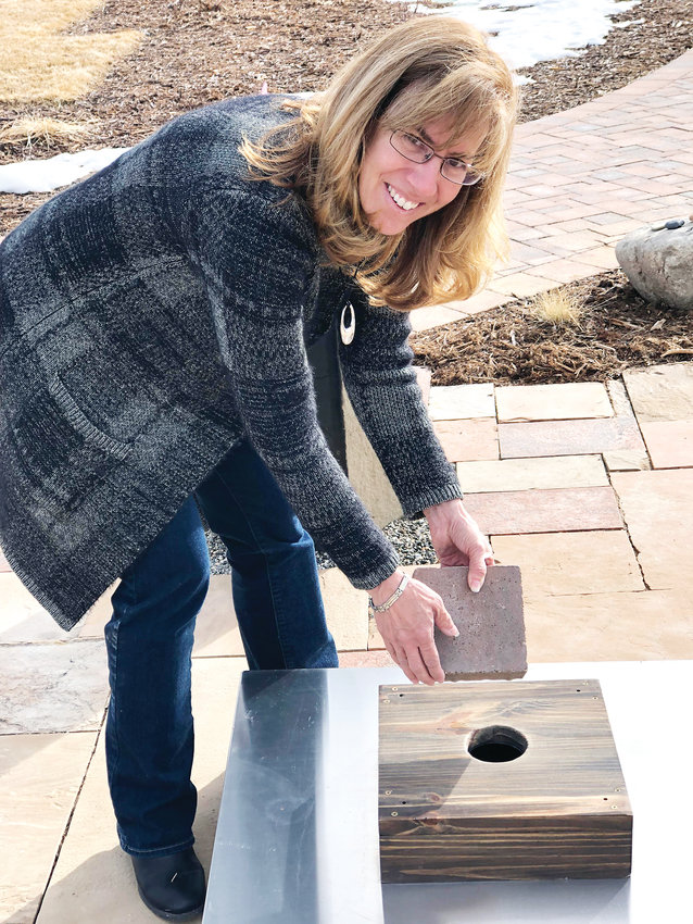 Rebecca Holm, director of customer care at Seven Stones, opens a 10-foot deep ossuary located on the western edge of the cemetery. On March 1, two people were able to place loved ones' ashes in the ossuary for free.