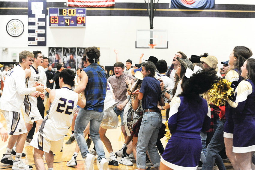 Holy Family students storm the floor following the Tigers' CHSAA Great 8 playoff win over Mead last Saturday, which earned Holy Family a trip to the Boys 4A Final Four. The Tigers will meet top-seeded Lewis-Palmer, Friday, March 8, at the Denver Coliseum.