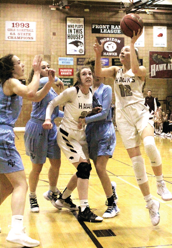 Lady Hawks' senior Alyssa Jimenez makes the left-handed layup against Ralston Valley Feb. 26.
