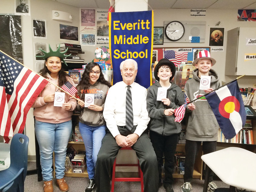 Bill Gold, center, the eighth-grade social studies teacher at Everitt Middle School in Wheat Ridge, and four of his students — from left, Brittney Guerrero, Angelina Kyle-Lopez, Esai Valdez and Jimmy Young — hold American flags and their personal, pocket-sized books of the U.S. Constitution. The books were recently provided to 250 eighth-graders courtesy of the Wheat Ridge Optimist Club.