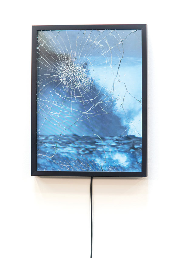 "One of Conor King's photos that will be displayed as part of ""Elements"" at Walker Fine Art. King's work combines photography and videography to tell the story of a rogue wave that shattered the glass of a lighthouse."
