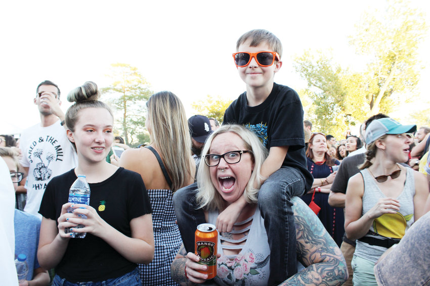 Jennifer Matamoros holds Brady Ferguson on her shoulders during Phoenix's performance at Grandoozy. The first Grandoozy festival was in in the Overland Park Golf Course last September.