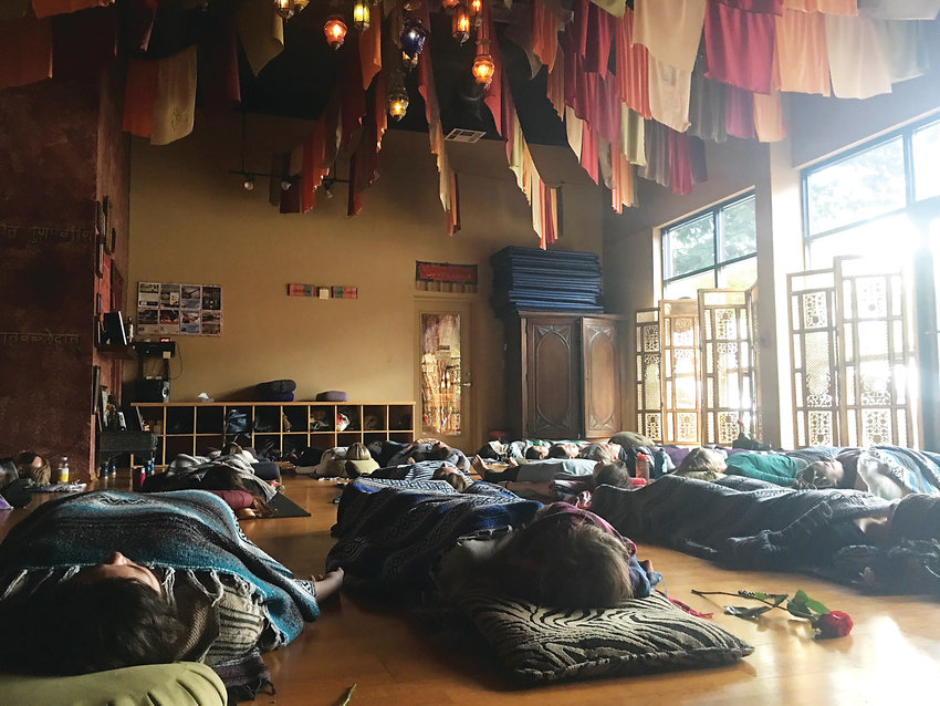In yoga nidra people lay on their backs and are guided through a meditation that helps people relax. Katrina Gustafson said nidra is a good entry point for people who have never tried yoga before.