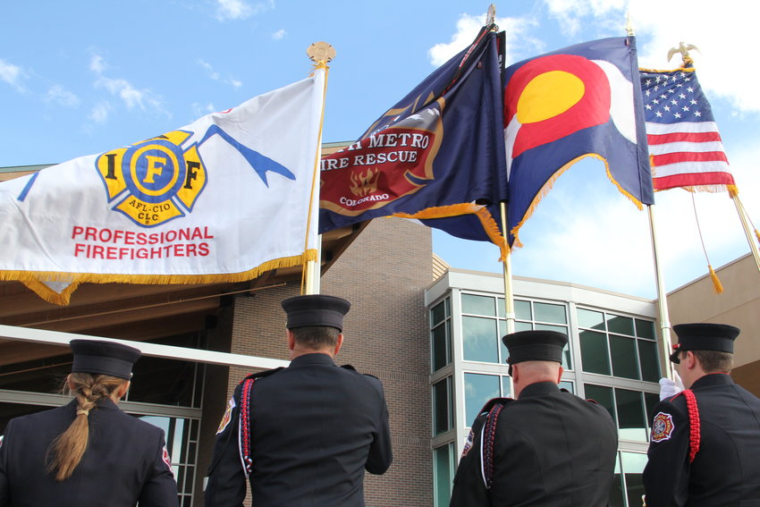 From left, first responders hold up flags for the Colorado Professional Firefighters union, South Metro Fire Rescue, Colorado and the country March 8 at Mission Hills Church in Littleton, near the end of a memorial service for Cody Mooney.
