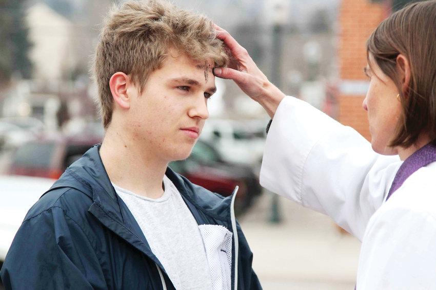 Jonathan Brooks, 18, stops by the Ashes to Go event in Castle Rock on March 6 to observe Ash Wednesday.