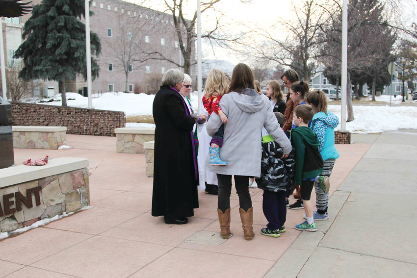 "People stopped by Fourth and Wilcox streets in Castle Rock for some ""Ashes-to-Go"" on March 6."