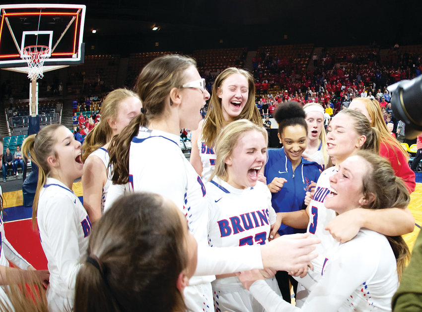 The Cherry Creek girls basketball team celebrates winning the 5A State final over Grandview 51-49 Saturday at the Denver Coliseum.