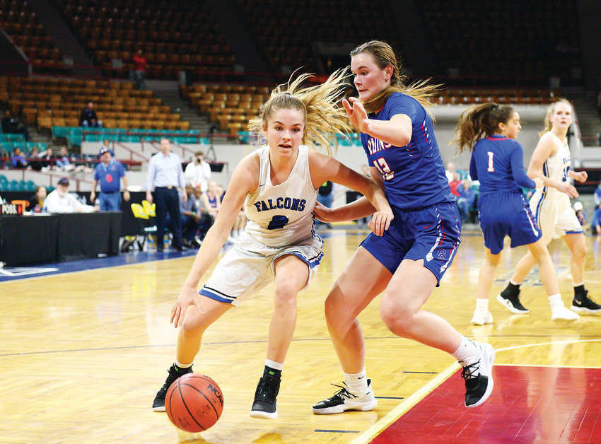 Highlands Ranch's Jamie Bain, left, tries to find a clean lane as she is cut off by Cherry Creek's Cali Clark. The Bruins ended up on top 53-52 in Final Four action March 7 at the Denver Coliseum.