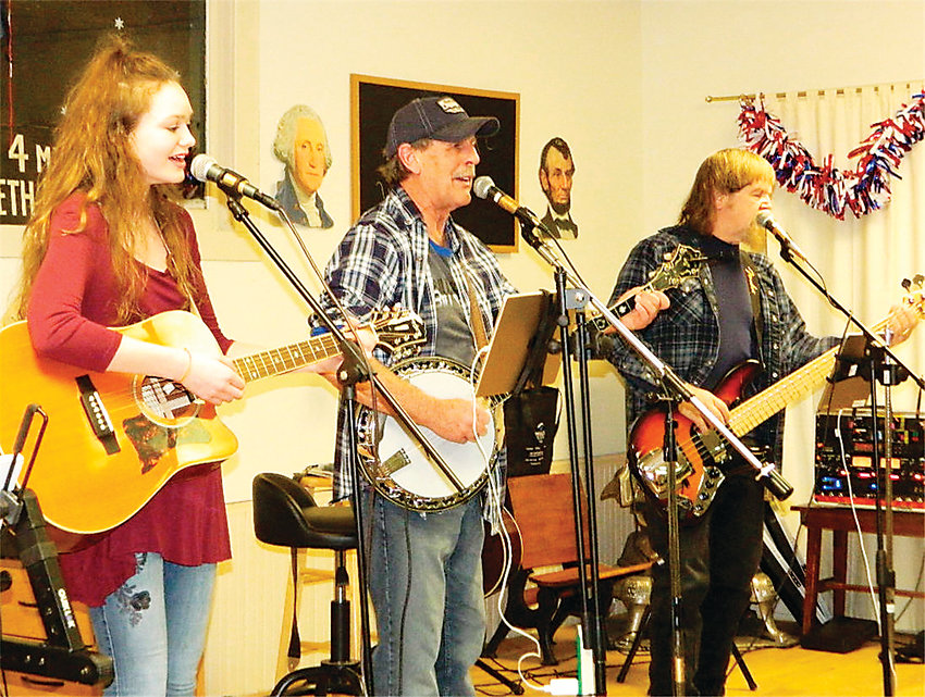 Franktown musicians perform at the Hilltop Schoolhouse concert March 2. Donations at the free concert went to a Parker-generated military mission for overseas soldiers. From left, Olivia Angus, Stanley Plant, and Richard Linwood.