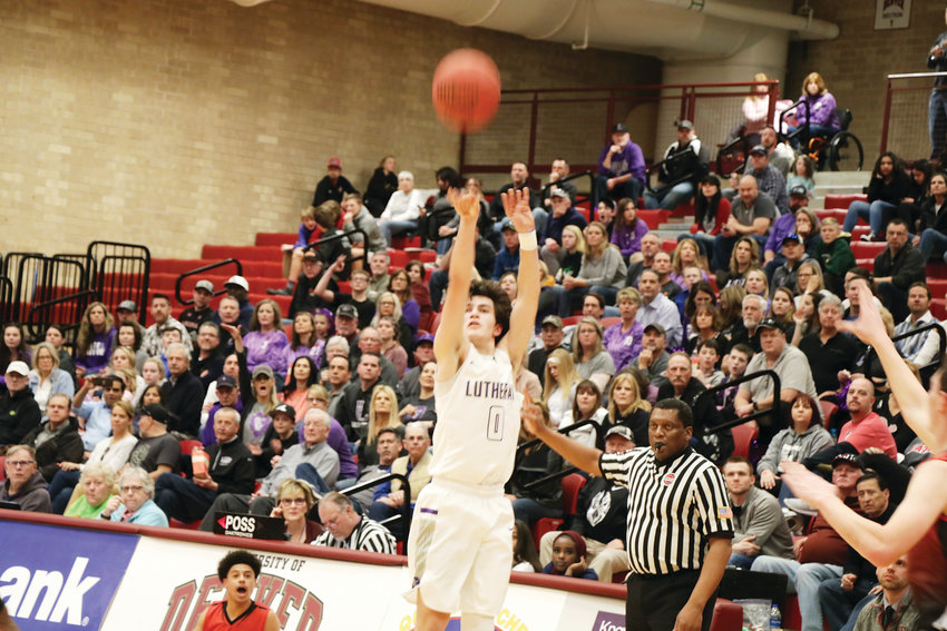 The Lutheran Lions' Josh Greiving launches an outside shot during the March 7 Class 3A state boys playoff game against DSST Stapleton. The game was close but the Knights hit free throws in the closing minutes and won the game 59-55.