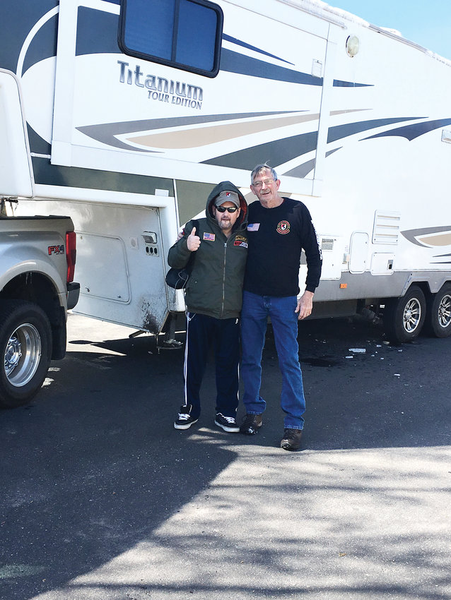 Christian Redman, left, and Ray Simpson, a fellow Blackhorse veteran from Colorado Springs, stand in front of Simpson's camper March 5 in Parker.  two were scheduled to leave on the first leg of Maverick's Last Ride, Redman's caravan trek to Kentucky and Key West. But Redman became sick right before leaving. He was able to fly to Louisville on March 8 and join Simpson and other veterans there in time for his daughter's March 10 birthday.