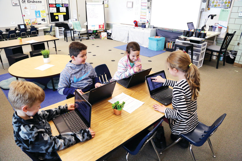 First-grade students at Fremont Elementary in Arvada use touch-screen Chromebooks. The devices were bought with a 2019 innovation grant with a goal to bridge the technology gap between kindergarten and second grade.